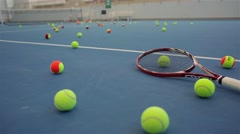Tennis bolls on a court and racket.  Stock Footage