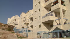 A pan over residentual houses in Efrat, a Jewish settlements in the West Bank Stock Footage