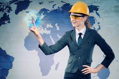 Female construction worker in globalisation concept Stock Photos