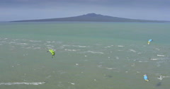 Aerial of Kitesurfers surfing in front of rangitoto island Auckland New Zealand Stock Footage