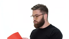 Bearded man reading a book Stock Footage