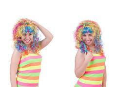Woman with colourful wig isolated on white - stock photo