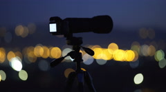The camera stand on the background of night city light. Wide angle. Real time Stock Footage