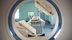 Unrecognizable hospital patient lying on MRI, tomograph, scanner, moving to and Stock Footage