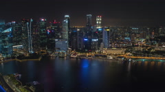 Night Aerial Time-lapse of Marina Bay Singapore Overlooking Business District Stock Footage