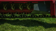 Rotary rakes are approaching the ground and are turning around grass Stock Footage