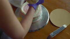 Confectioner preparing cake with meringue and berries Stock Footage