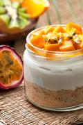 cheesecake in a  jar with mango and passionfruit - stock photo