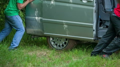 Helping to move a van Stock Footage