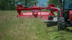 Cutting grass with grass cutting machine Stock Footage