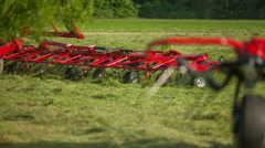 Two people are working outside on a tractor and with a mower conditioner Stock Footage