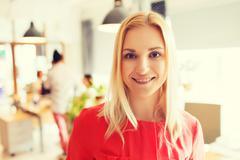 Happy creative woman at office or bureau Stock Photos