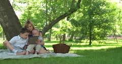 Young mother, read a book to her tho children Stock Footage