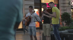 Street musicians play instruments Stock Footage