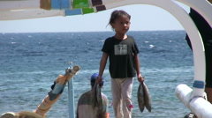 Balinese kids carrying some fishes at Amed beach Stock Footage