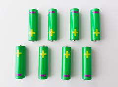 close up of green alkaline batteries - stock photo