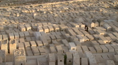 Jerusalem's Mount of Olives Graveyard with a praying Jew Stock Footage