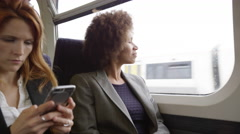 Afro American commuter on her way to work looking out of the window Stock Footage