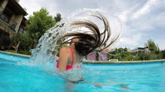 A woman who throws with wet hair in the pool. Stock Footage