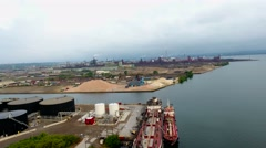 Aerial of Industrial Cargo Ship In Port At Steel Production Factory In Canada Stock Footage