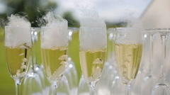 Wineglasses with nitrogen champagne Stock Footage
