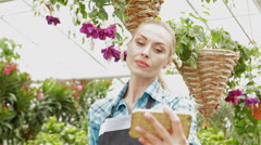 Female florist makes selfie at the garden centre - stock footage
