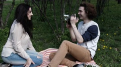 Happy Couple shoot old video, cinema in park city, slow motion, 4K, UHD, UltraHD - stock footage