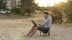 Young Business Man Working Remotely on Beach Stock Footage