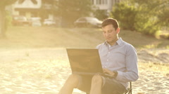 Young Business Man Working Remotely on Beach - stock footage