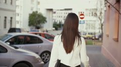 Woman walking in old city at sunset. slow mo - stock footage