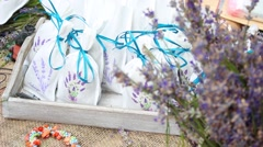 Pillows are filled with medical flowers. Hand tied with pretty satin ribbons Stock Footage