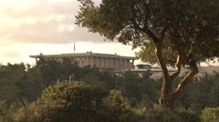 The Knesset, Israel's House of Parliament, with an ancient olive tree  Stock Footage
