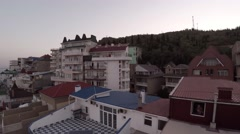 Hotels on the Black Sea in Crimea.  Drone flies from the roof of the hotel. Stock Footage