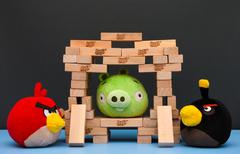 Bomb and Red Angry Birds with Bad Piggy in Jenga castle Stock Photos