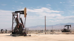 Oil wells pumping Maricopa CA Stock Footage