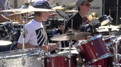 Some young guys at the same time playing the drums, Riga, Latvia Stock Footage