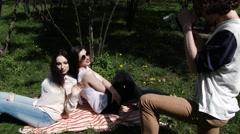 Happy three friends shoots old cinema in park city, slow motion, 4K UHD UltraHD Stock Footage