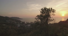 Kata Noi Beach in Phuket Thailand at Sunset Descending Pan Drone Footage Stock Footage