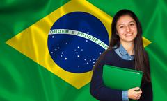 Teen student smiling over brazilian flag Stock Photos