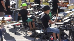 Two very young boys playing drums in orchestra, Riga, Latvia Stock Footage