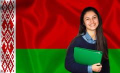 Teen student smiling over Belarusian flag - stock photo