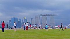 UHD 4K Asia Singapore Skyline over Financial district Sands hotel Sky Park Stock Footage
