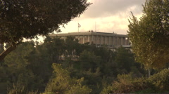 The Knesset, Israel's Houses of Parliament in Jerusalem, framed by trees Stock Footage
