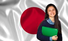 Teen student smiling over japanese flag Stock Photos