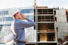 Man the chief engineer at  construction site screams of danger Stock Photos