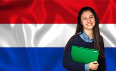 Teen student smiling over Dutch flag Stock Photos