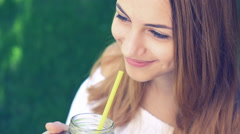 Girl drinking iced tea with peach. Stock Footage