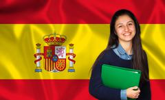 Teen student smiling over Spanish flag Stock Photos