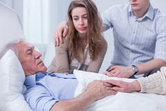 Saying goodbye to the oldest family member - stock photo