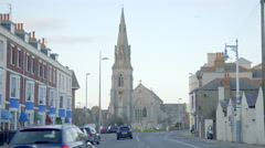 Street and church in Weymouth, England Stock Footage
